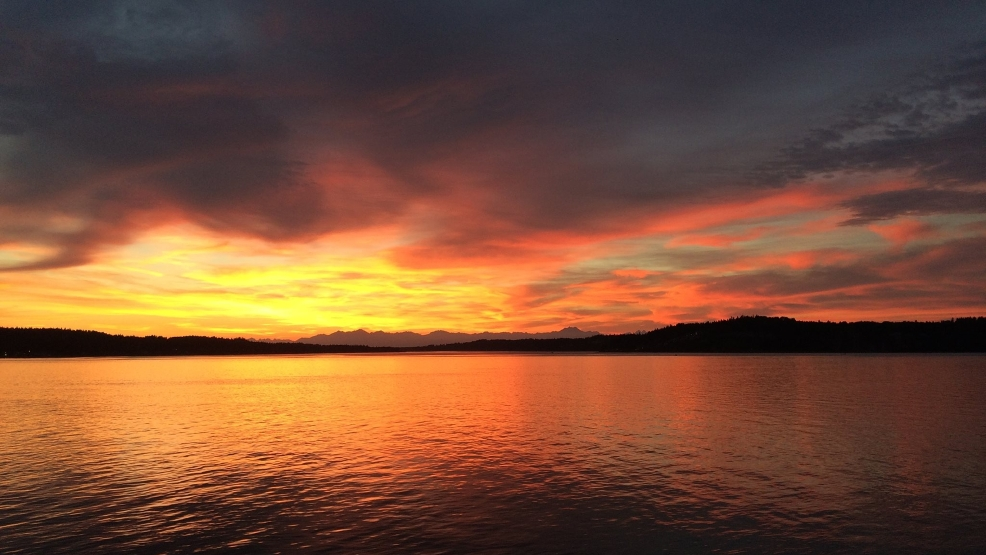 Photos: Fiery sunset lights up Western Washington skies