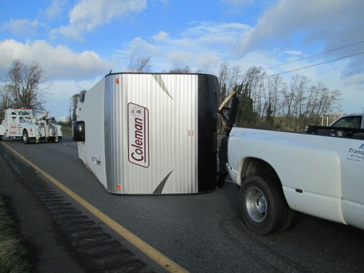 Strong winds blew over a camping trailer on Highway 20 between Anacortes and Burlington. (WSP photo)