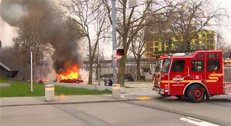 In this image made from video provided by KOMO-TV, smoke rises from the scene of a news helicopter crash outside the KOMO-TV studios near the space needle in Seattle, Tuesday, March 18, 2014, in Seattle.