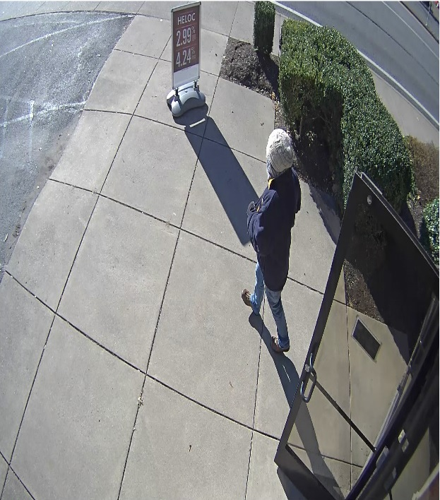 The suspect in the Kanawha City bank robbery leaves the scene. (Charleston Police Department)<p></p>