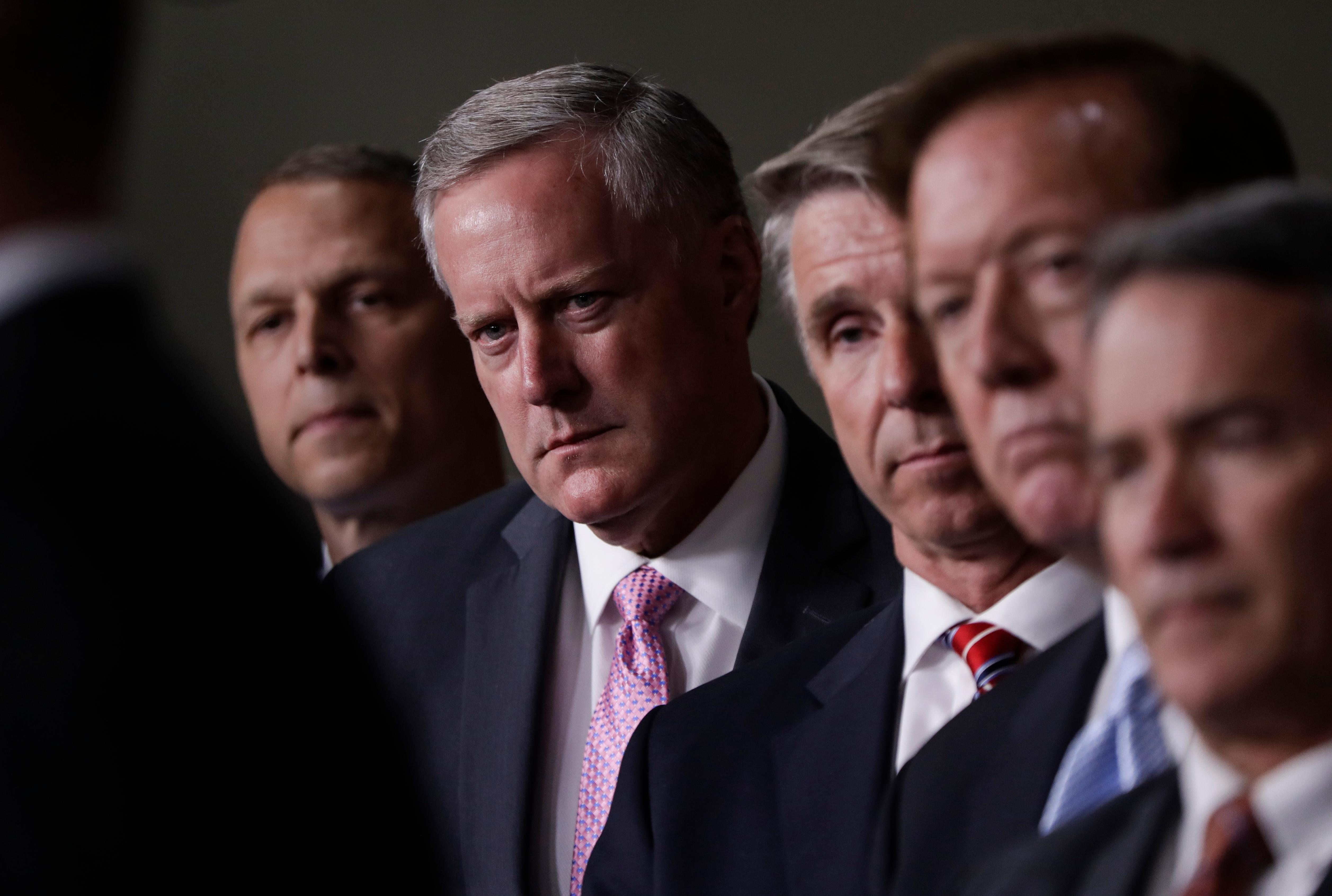 House Freedom Caucus Chairman Rep. Mark Meadows, R-N.C., second from left, and others participate in a news conference on Capitol Hill in Washington, Wednesday, July 12, 2017. (AP Photo/J. Scott Applewhite)