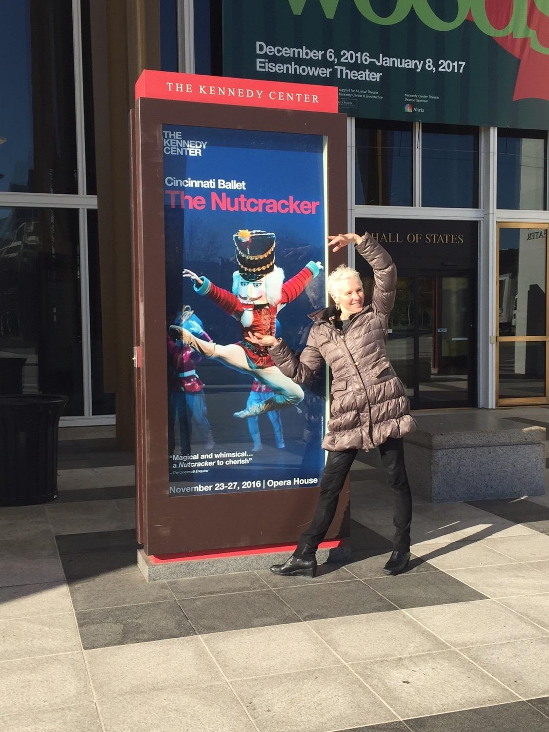 Artistic Director and CEO Victoria Morgan in front of the Cincinnati Ballet boards at the Kennedy Center. / Image courtesy of the Cincinnati Ballet