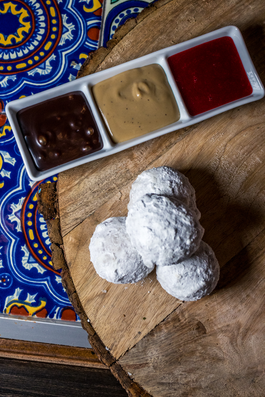 Ricotta Donuts coated in powdered sugar with a trio of dipping sauces / Image: Catherine Viox // Published: 4.21.20