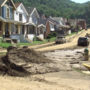 Sen. Manchin visits areas torn by flooding in northern W.Va.