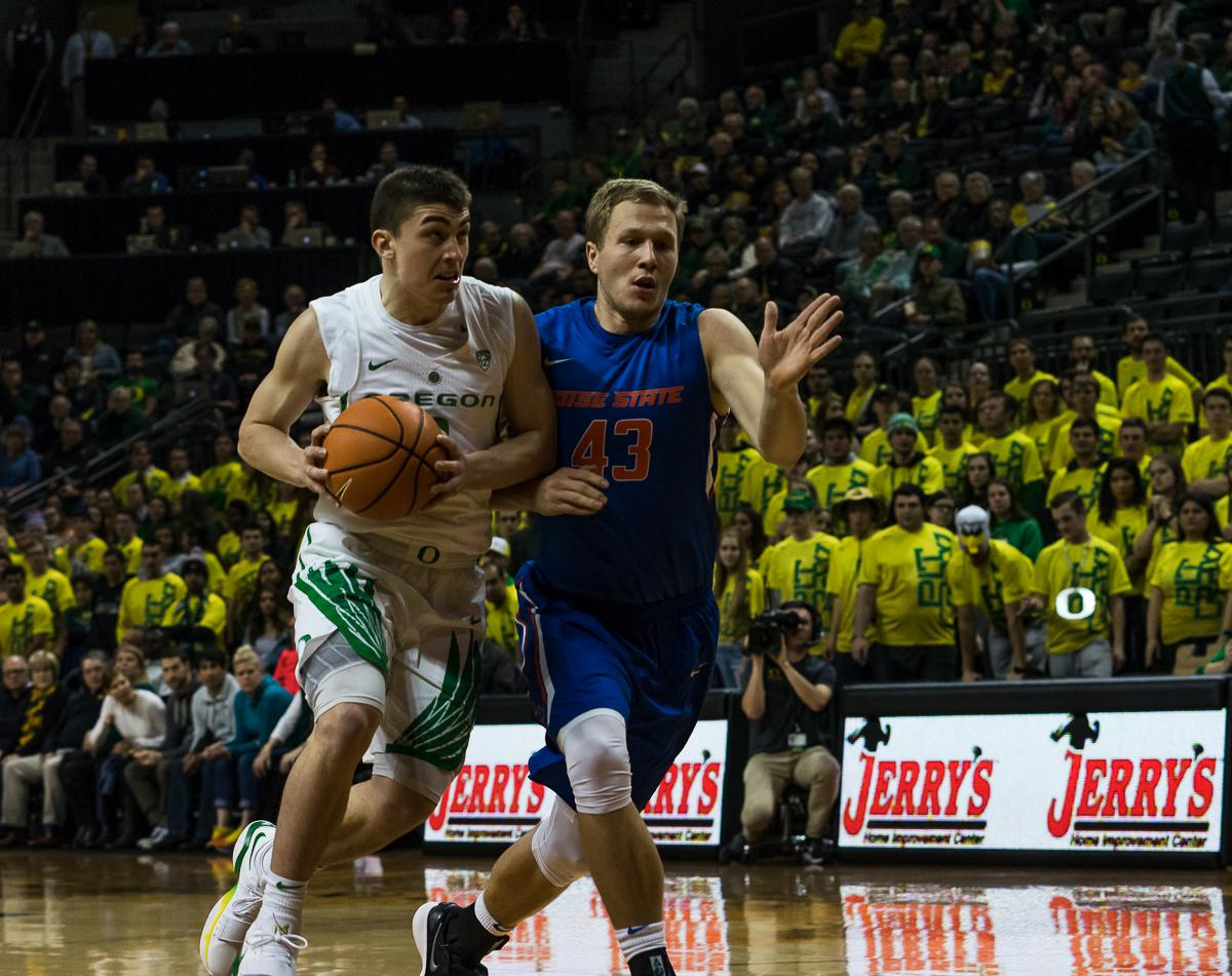 The University of Oregon's Payton Pritchard (#3) dribbles past Boise State's Chris Sengfelder (#43). The Boise State Broncos defeated the Oregon Ducks 73 – 70 at Matthew Knight Arena in Eugene, Ore., on December 1, 2017. Photo by Kit MacAvoy, Oregon News Lab
