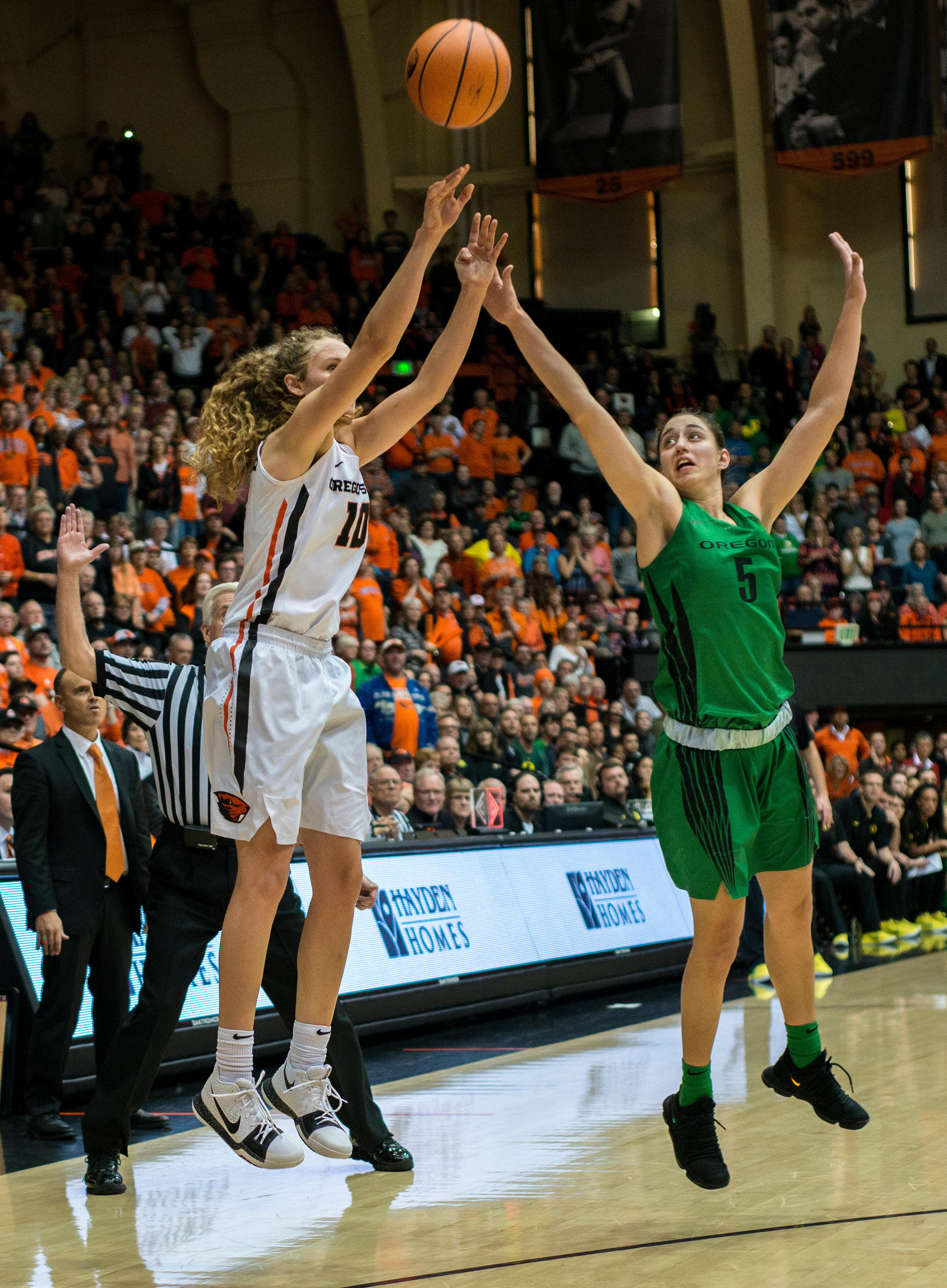 Oregon State Beavers guard Katie McWilliams (#10) shoots as Oregon Ducks guard Maite Cazorla (#5) leaps to block.The Oregon Ducks were defeated by the Oregon State Beavers 85-79 on Friday night in Corvallis. Sabrina Ionescu scored 35 points and Ruthy Hebard added 24. The Ducks will face the Beavers this Sunday at 5 p.m. at Matthew Knight Arena. Photo by Abigail Winn, Oregon News Lab