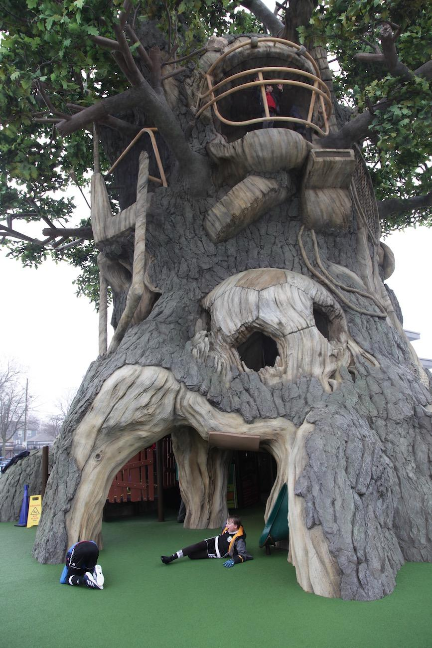 The Guild's Fantasy Tree House of Sports stands 60-feet tall as the centerpiece of the Riley Children's Health Sports Legends Experience. The tree is an assemblage of various sports gear and allows little tykes to develop curiosity, confidence, and persistence as they climb within the maze-like jungle gym within. / Image: Chez Chesak // Published: 4.2.19