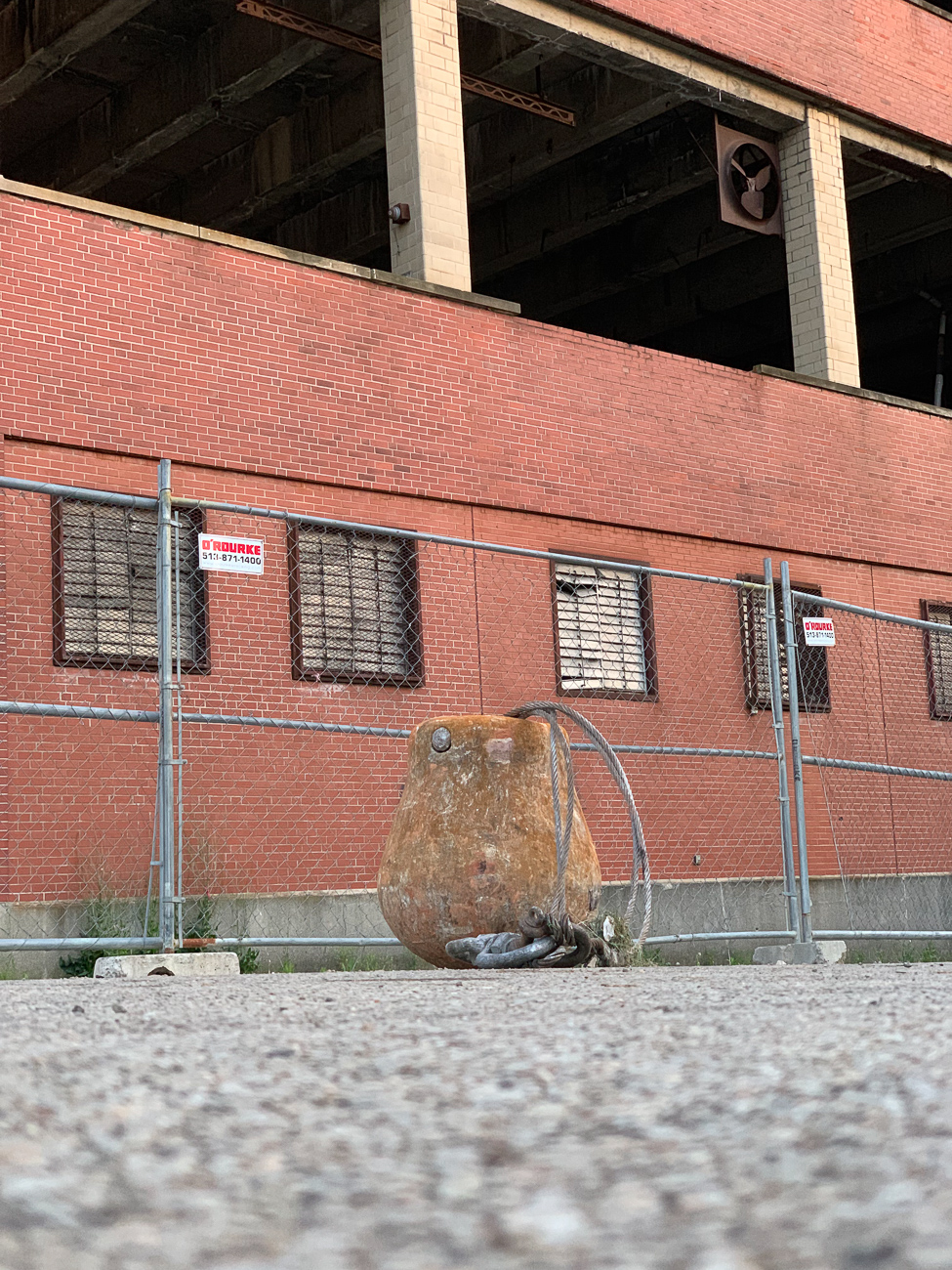 The wrecking ball sits on the pavement outside of the building. / Image: Phil Armstrong // Published: 6.14.19