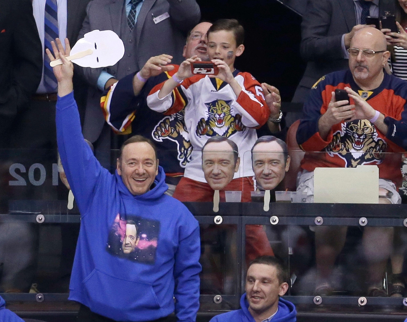 Actor Kevin Spacey waves to the fans during an NHL hockey game between the Florida Panthers and the Detroit Red Wings in Sunrise, Fla., Saturday, March 19, 2016. (AP Photo/Alan Diaz)