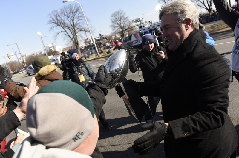 A fan reaches out to touch the Lombardi Trophy carried by Philadelphia Eagles NFL football team head coach Doug Pederson during the Super Bowl LII victory parade, Thursday, Feb 8, 2018, in Philadelphia. (AP Photo/Michael Perez)<p></p>