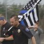 Officer makes 200+ mile trek to honor fallen first responders