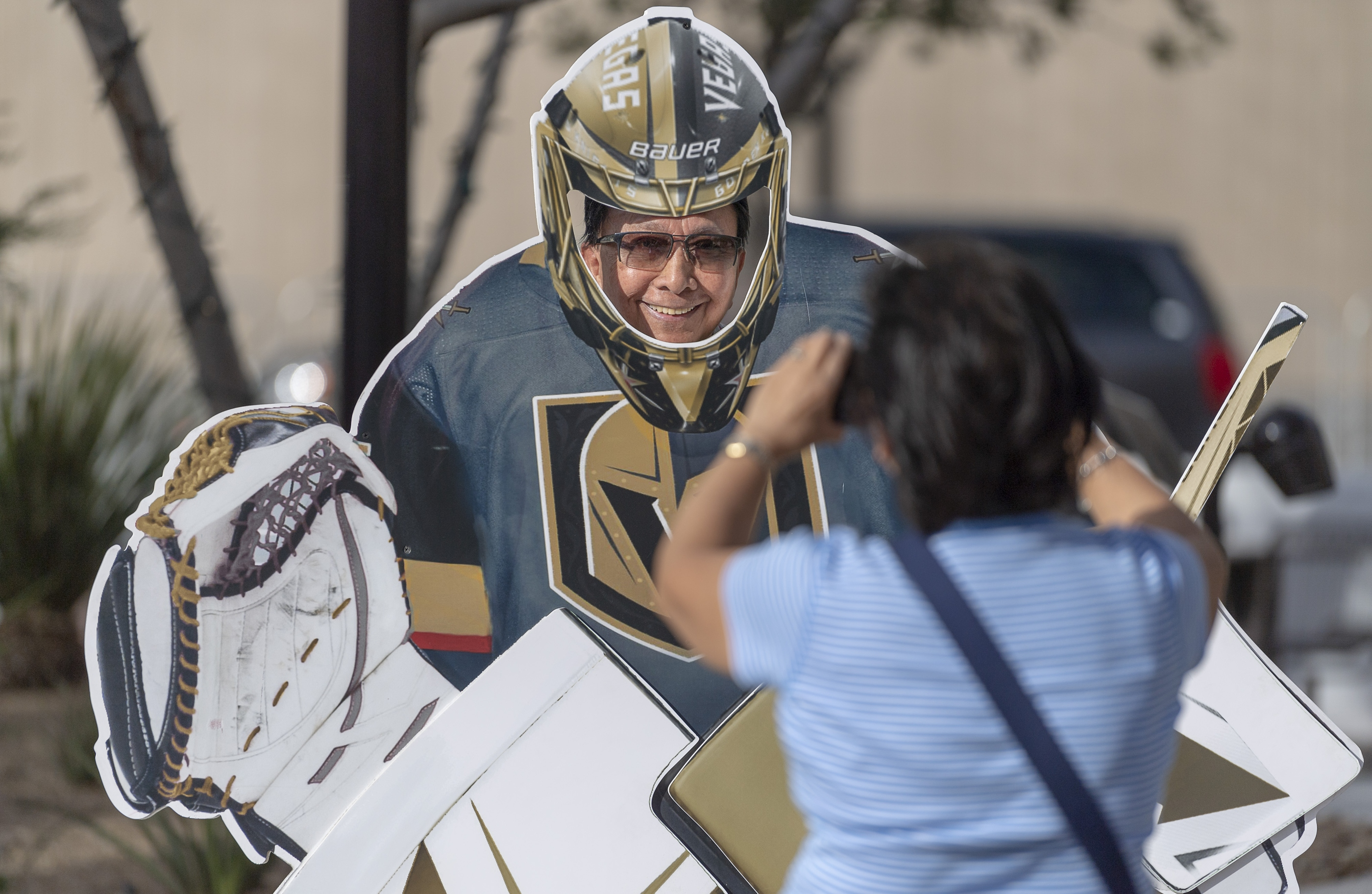 A visitor poses as the goalie for a photo in the pre-game celebration in Toshiba Plaza as the Vegas Golden Knights prepare to meet the Los Angeles Kings in the first quarterfinal game of the NHL Stanley Cup Playoffs at T-Mobile Arena in Las Vegas on Wednesday, April 11, 2018.  CREDIT: Mark Damon/Las Vegas News Bureau