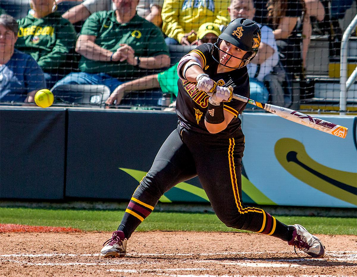 The Sun Devils' Sashel Palacios (#13) swings for the ball. The Oregon Ducks Softball team took their third win over the Arizona Sun Devils, 1-0, in the final game of the weekends series that saw the game go into an eighth inning before the Duck?s Mia Camuso (#7) scored a hit allowing teammate Haley Cruse (#26) to run into home plate for a point. The Ducks are now 33-0 this season and will next play a double header against Portland State on Tuesday, April 4 at Jane Sanders Stadium. Photo by August Frank, Oregon News Lab