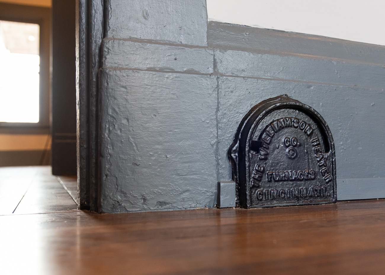 Tom debated removing the old thermostat built into the baseboard of the living room, but decided to keep it where it is so the next owner can enjoy a little piece of the house's history. / Image: Phil Armstrong, Cincinnati Refined // Published: 3.15.19