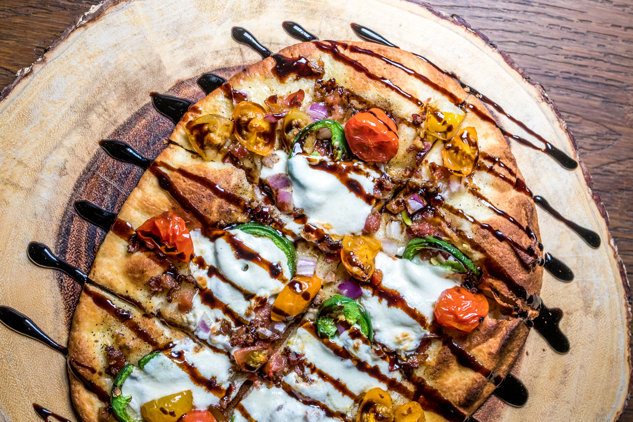 Northside Flatbread: naan flatbread, olive oil, cherry tomato, red onion, jalapeño, bacon, mozzarella, and balsamic glaze  / Image: Catherine Viox // Published: 2.25.21
