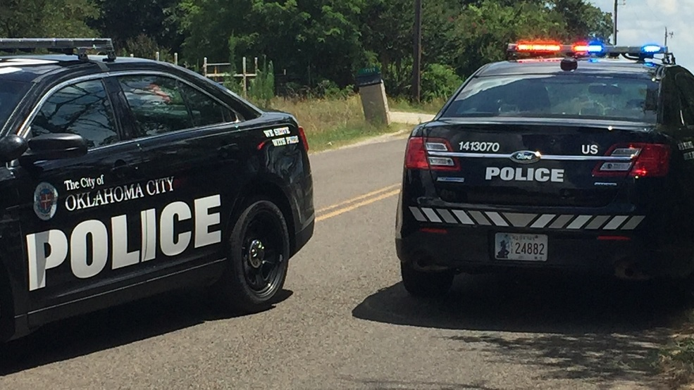 OKC - Two OKC police units block a road at the scene of a fatal crash in July 2017. (Josh Vascil KOKH).JPG