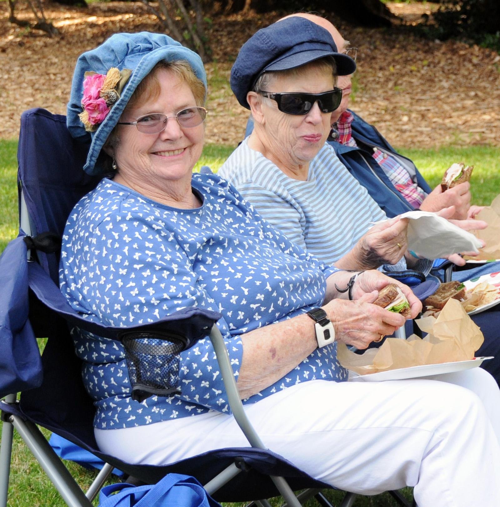 Many concert-goers bring a picnic to enjoy, like these Ashland City Band fans Dorothy Canfield (left) and Kathy Dewitt. (Photo by Jim Flint)