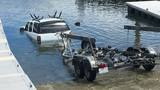 Photos: SUV, boat trailer submerge at Pierce boat ramp