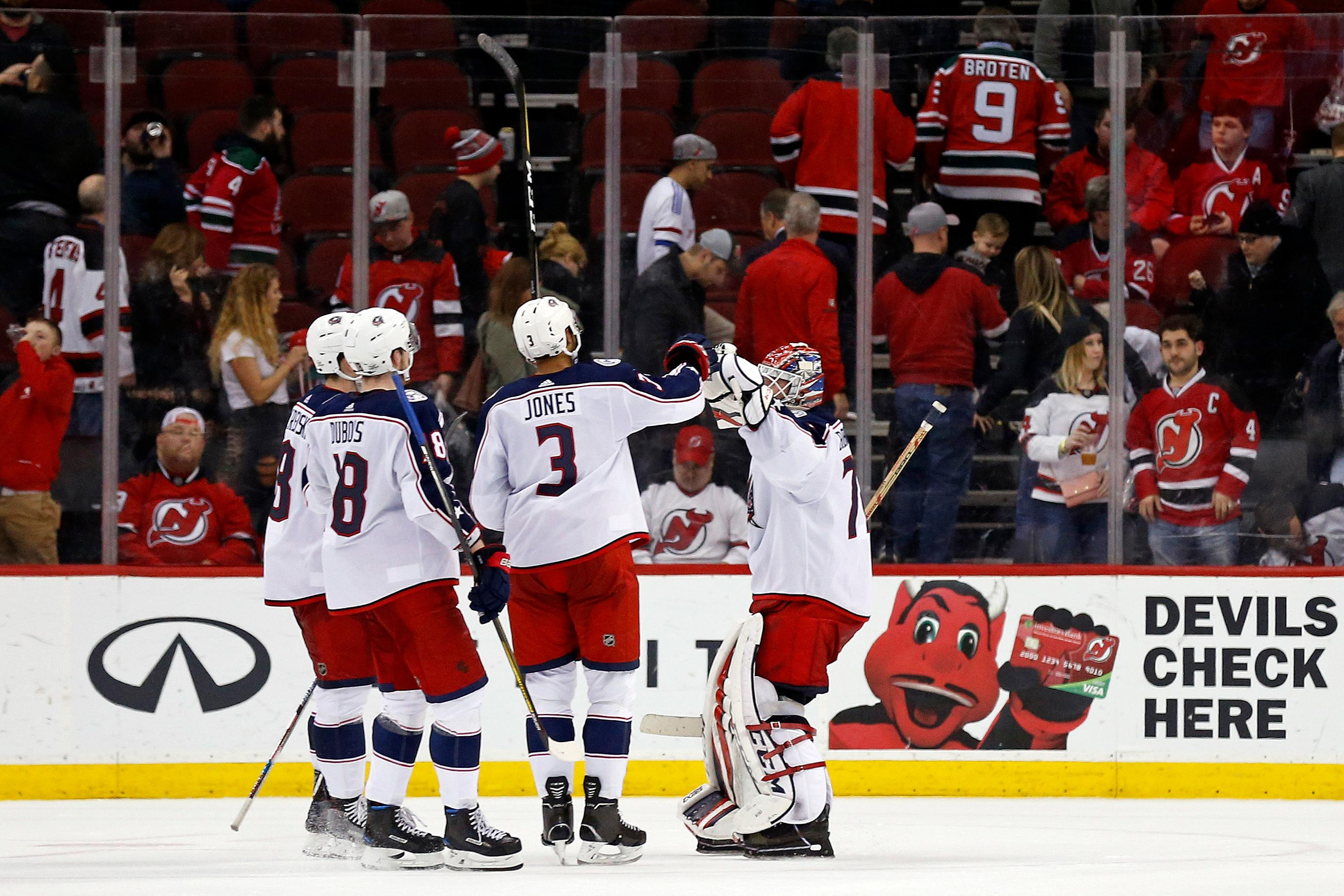 Columbus Blue Jackets goaltender Sergei Bobrovsky celebrates with defenseman Seth Jones (3) after the team's 2-1 win over the New Jersey Devils in an NHL hockey game, Tuesday, Feb. 20, 2018, in Newark, N.J. (AP Photo/Adam Hunger)