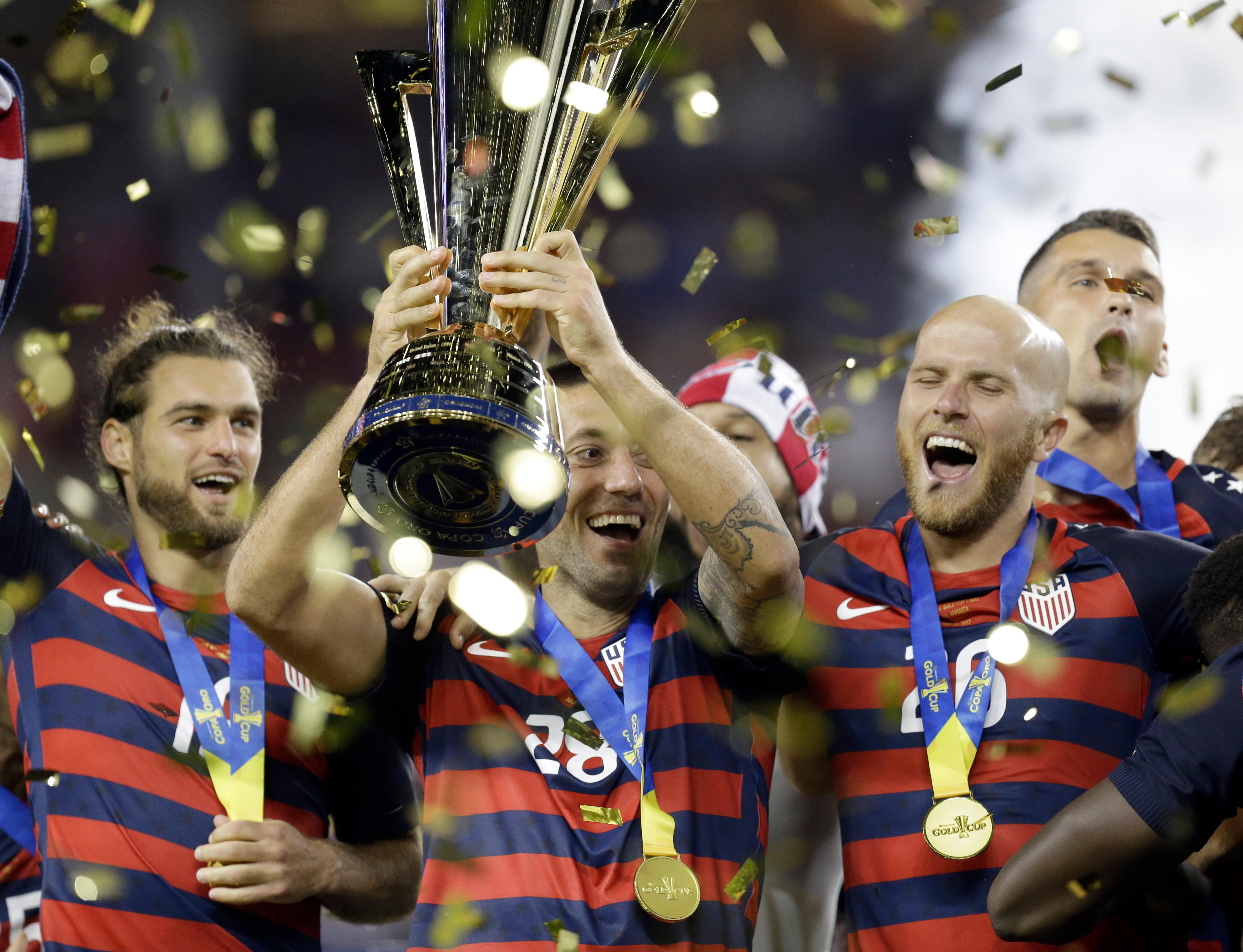 FILE - In this July 27, 2017, file photo, United States' Clint Dempsey raises the championship trophy after the United States beat Jamaica 2-1 in the Gold Cup final soccer match in Santa Clara, Calif. Dempsey has been named the MLS Comeback Player of the Year after a heart condition in 2016 put his career in jeopardy. Dempsey was the choice after scoring 12 goals in the 2017 regular season and reclaiming a place on the U.S. national team before the Americans fell short in in World Cup qualifying. (AP Photo/Ben Margot, file)