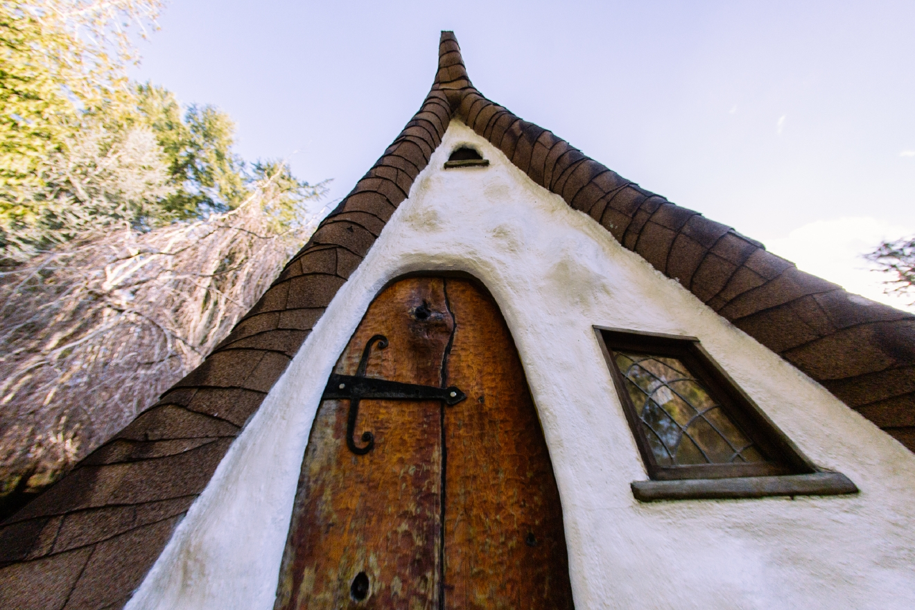 It's been almost a year since we visited the real-life Snow White's Cottage, located in Olalla, WA. What we think is the cutest little 4 bed/4.5 bath cottage is apparently having a slightly difficult time selling. The home just dropped from $925,000 to $775,000 - still selling by the Ellis Team with John L. Scott.  We get it, it's a special type of home for a special type of person (or seven people!). The storybook home features meticulous detail including the hand build doors, painted rock pavers, hand carved wood beams, stained glass windows and more. Everything about this house makes you feel like you're in Snow White's fantasy world. More info at ellisteam.johnlscott.com/search/listing/2936298. (Image: Josh Lewis / Seattle Refined)