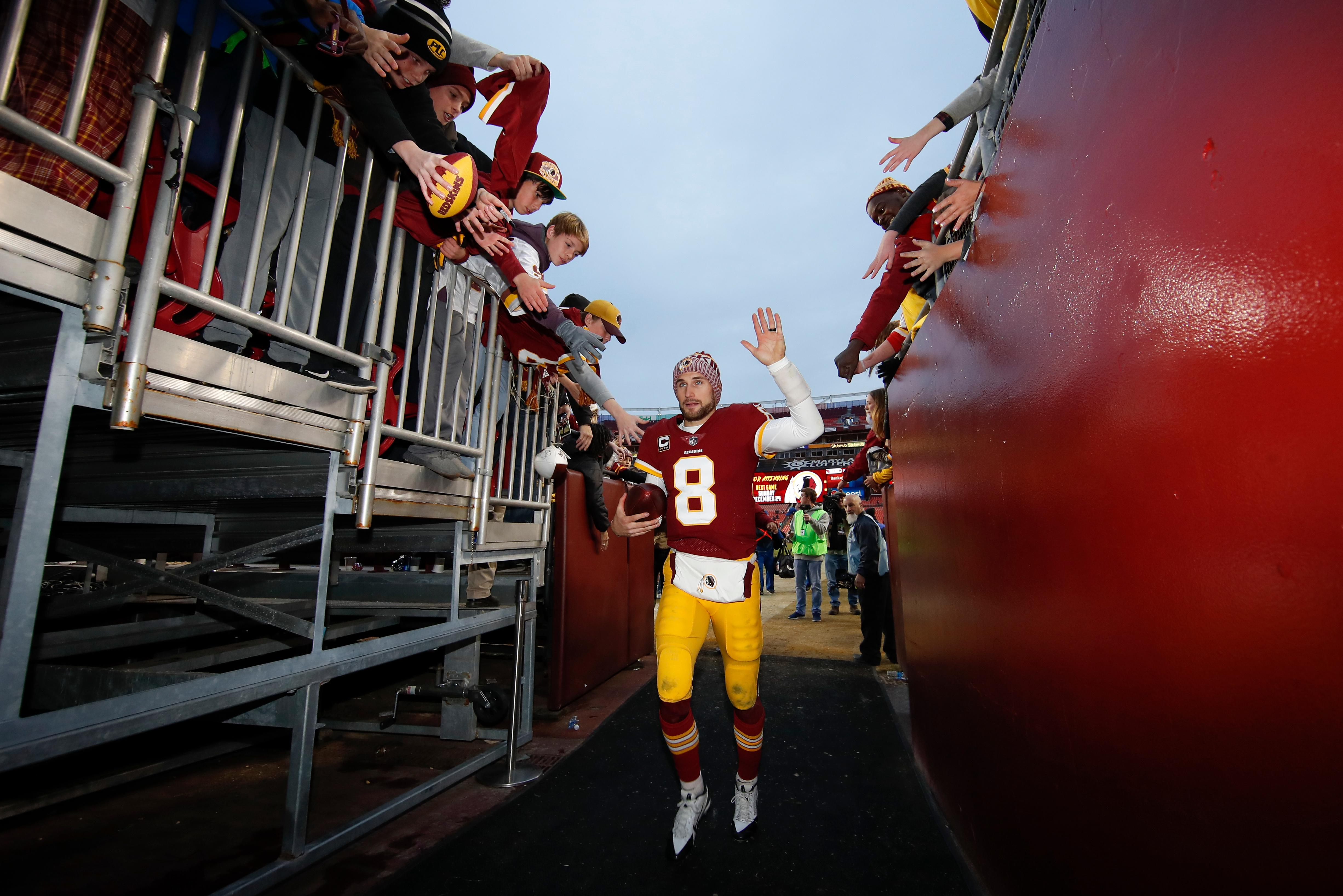 Washington Redskins quarterback Kirk Cousins (8) leaves the field after an NFL football game against Arizona Cardinals in Landover, Md., Sunday, Dec 17, 2017. The Redskins defeated the Cardinals 20-15. (AP Photo/Alex Brandon)