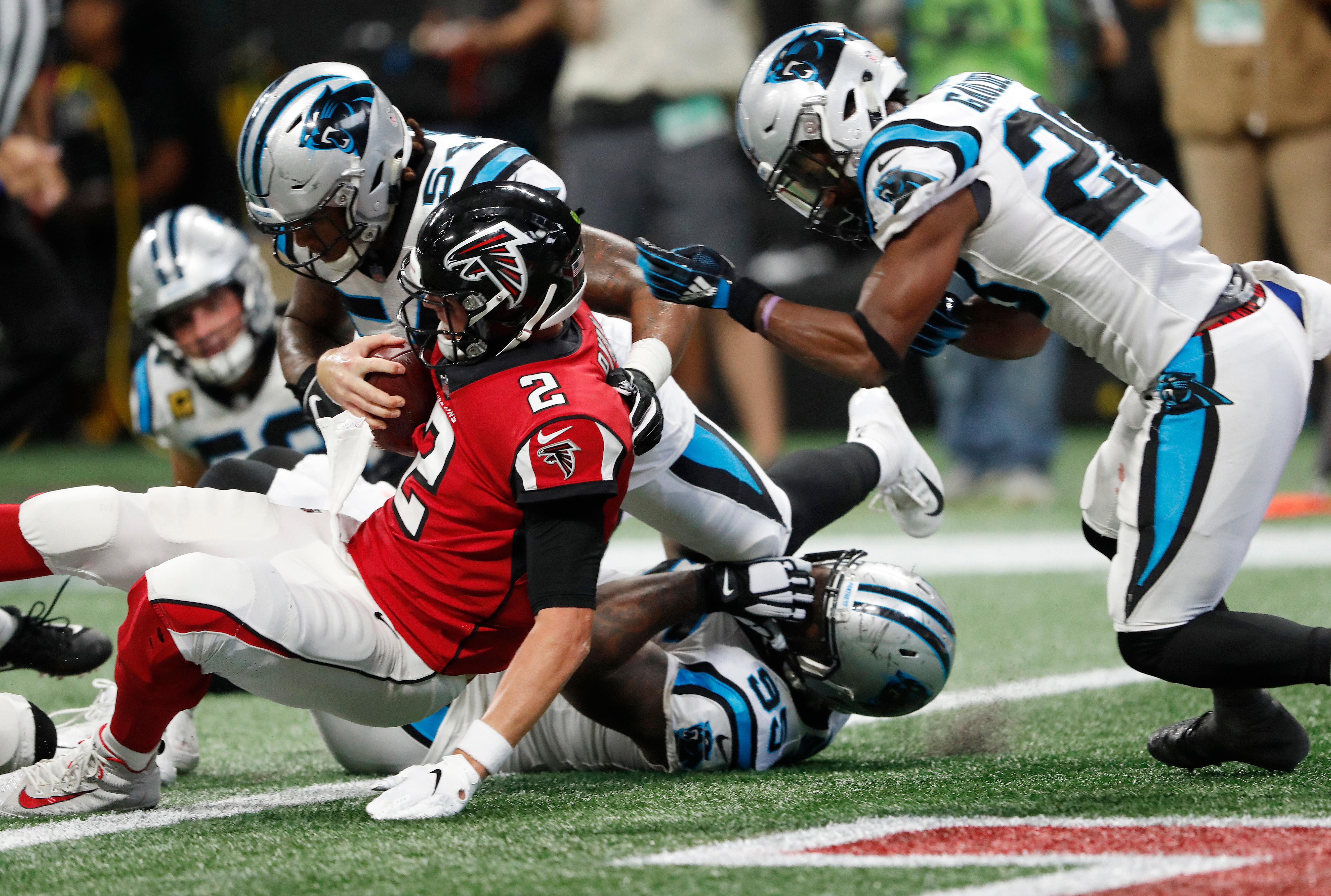 Atlanta Falcons quarterback Matt Ryan (2) leaps for a touchdown as Carolina Panthers linebacker Shaq Green-Thompson (54) defends during the second half of an NFL football game, Sunday, Sept. 16, 2018, in Atlanta. (AP Photo/John Bazemore)