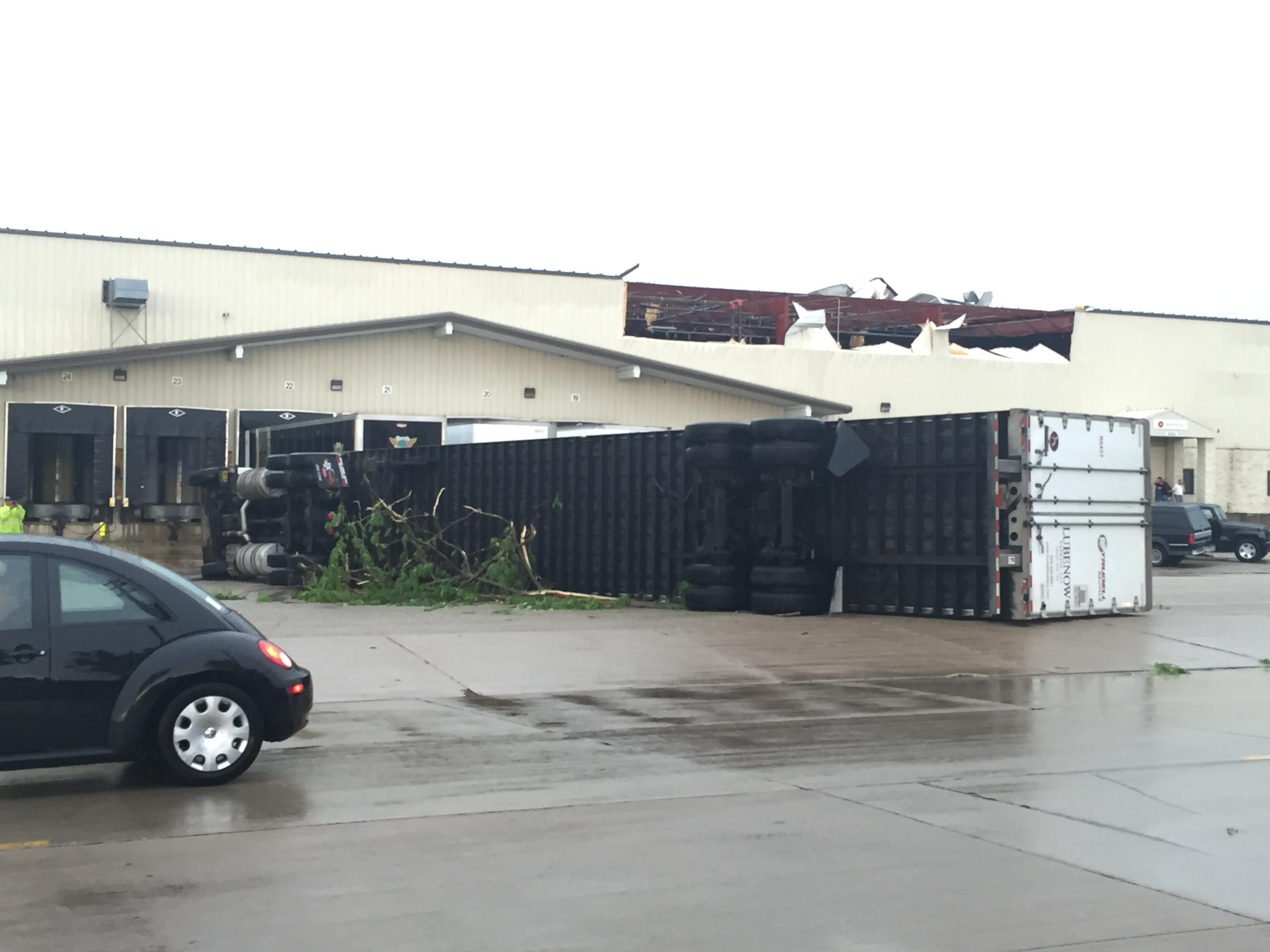 Semi is tipped on its side at Appvion warehouse in Appleton, June 14, 2017. (WLUK/Alex Ronallo)
