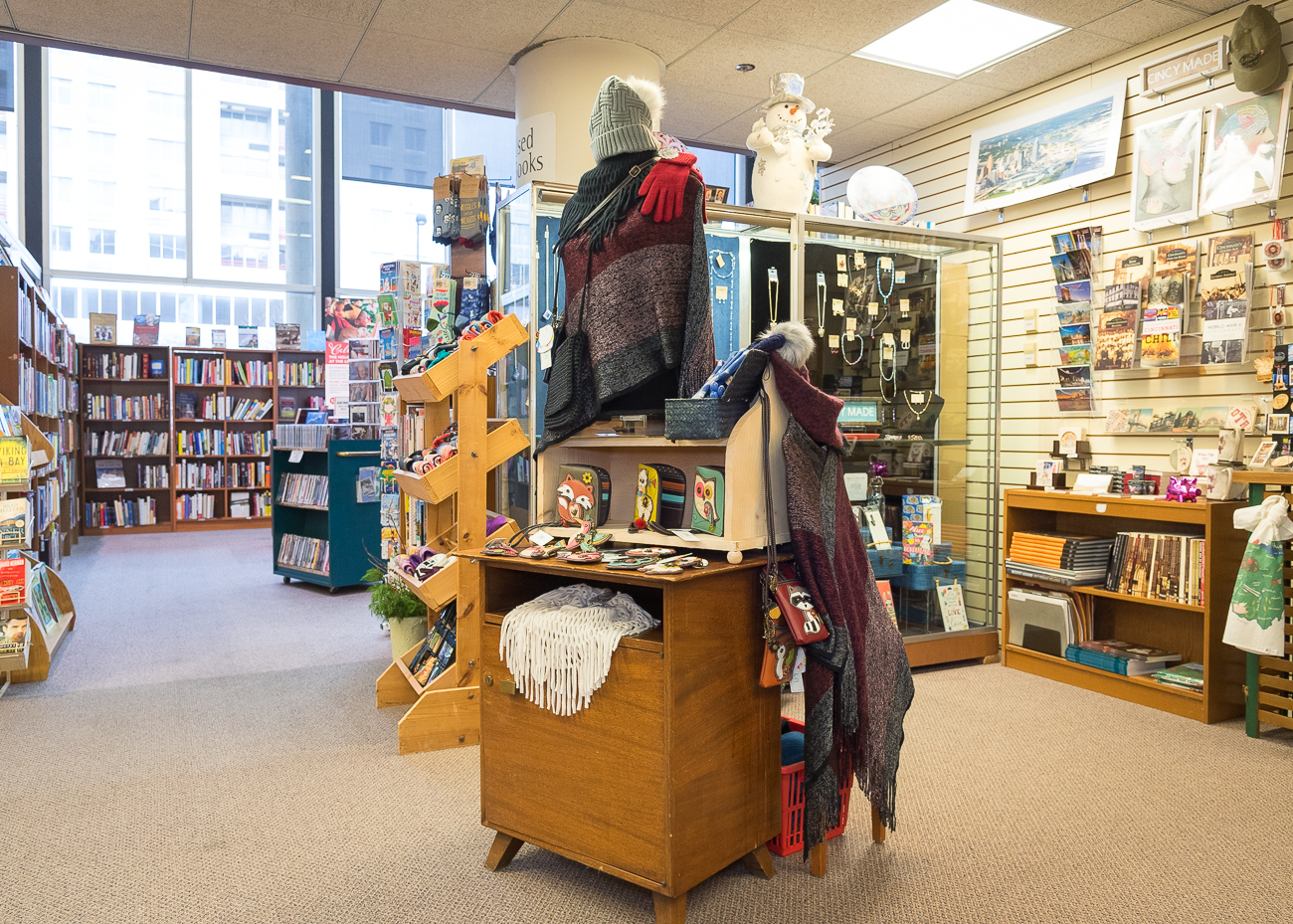 The Library Friends' Shop, located in the middle of the Main Library downtown, sells used books and media, greeting cards, literary gifts, clothing, and a variety of other curio. Proceeds from sales go back to help the Public Library continue to provide programming to people of all ages. The Friends of the Library is an over-60-year-old organization that is dedicated to helping fund programs for the Library. The Shop has been inside the Main Library since November of 1983 and in its current spot on the mezzanine for roughly 15 years. / Image: Phil Armstrong, Cincinnati Refined // Published: 12.13.18