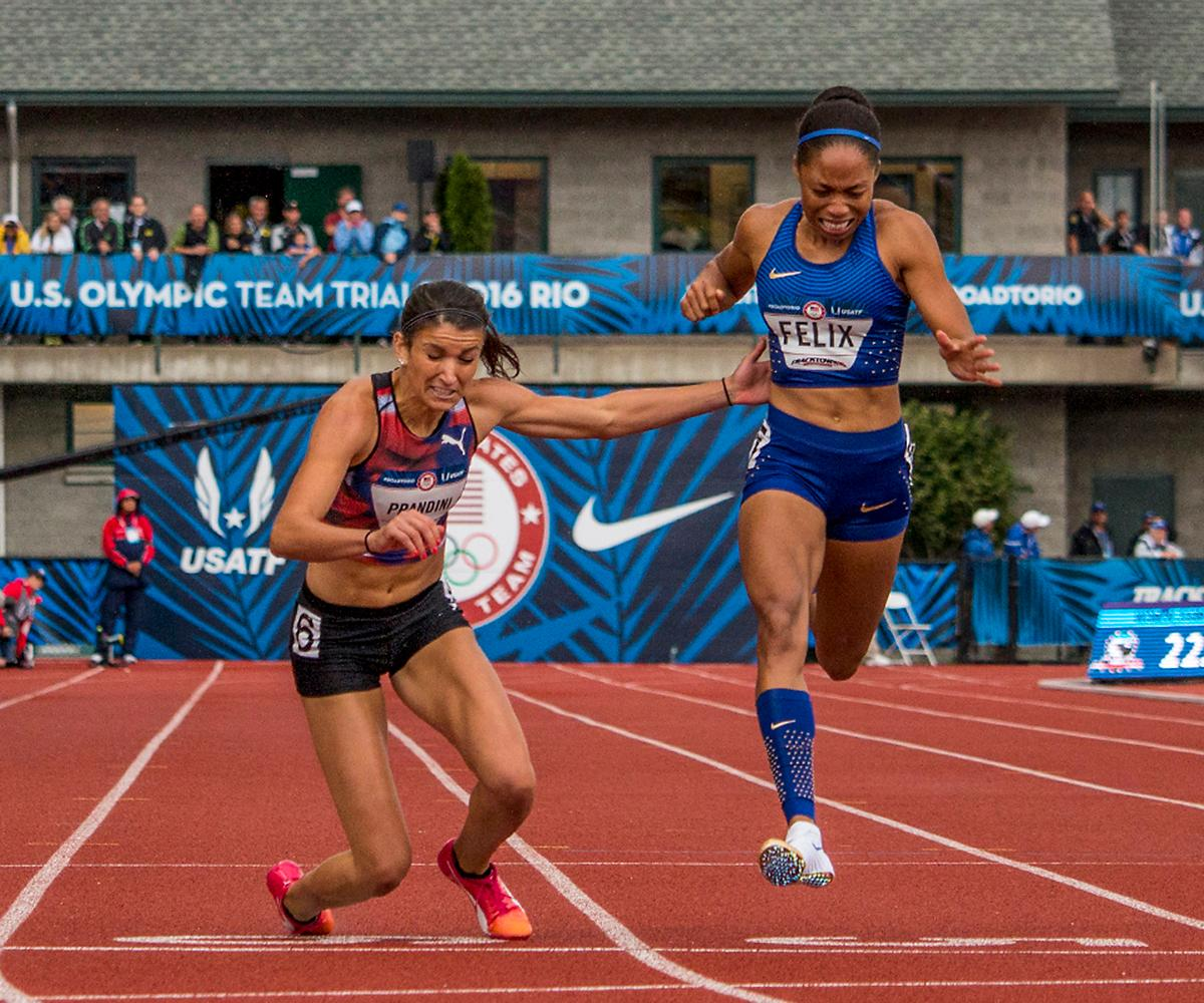 Puma�s Jenna Prandini falls at the finish line as Nike�s Allyson Felix leans in for the finish. Prandini placed third in 22.53 and Felix a close fourth in 22.54. Prandini will compete in Rio for Team USA.