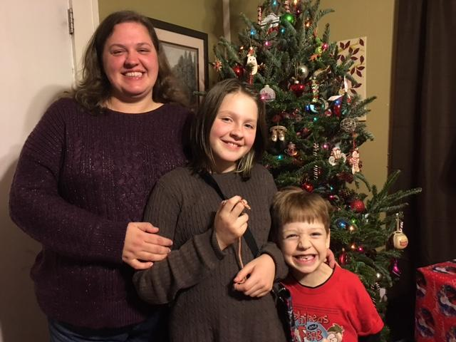 Jodi Allen, a single working Mom, pictured with her two children, was helped by ABCCM heating assistance bill program in November. (Photo credit: Jodi Allen)<p></p>