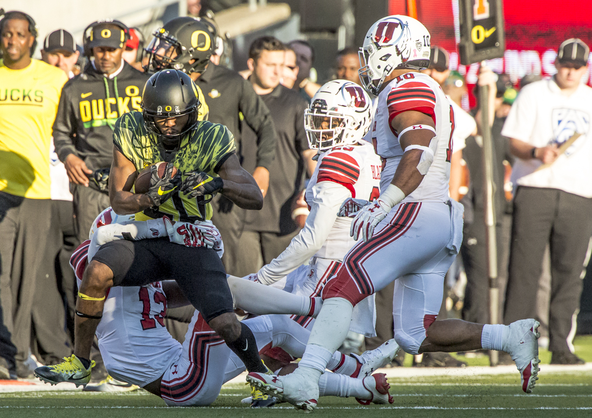 Oregon running back Tony Brooks-James (#20) attempts to break free from an Utah defender. The Oregon Ducks defeated the Utah Utes 41 to 20 during Oregon's homecoming game at Autzen Stadium on Saturday, October 28, 2017. Photo by Ben Lonergan, Oregon News Lab