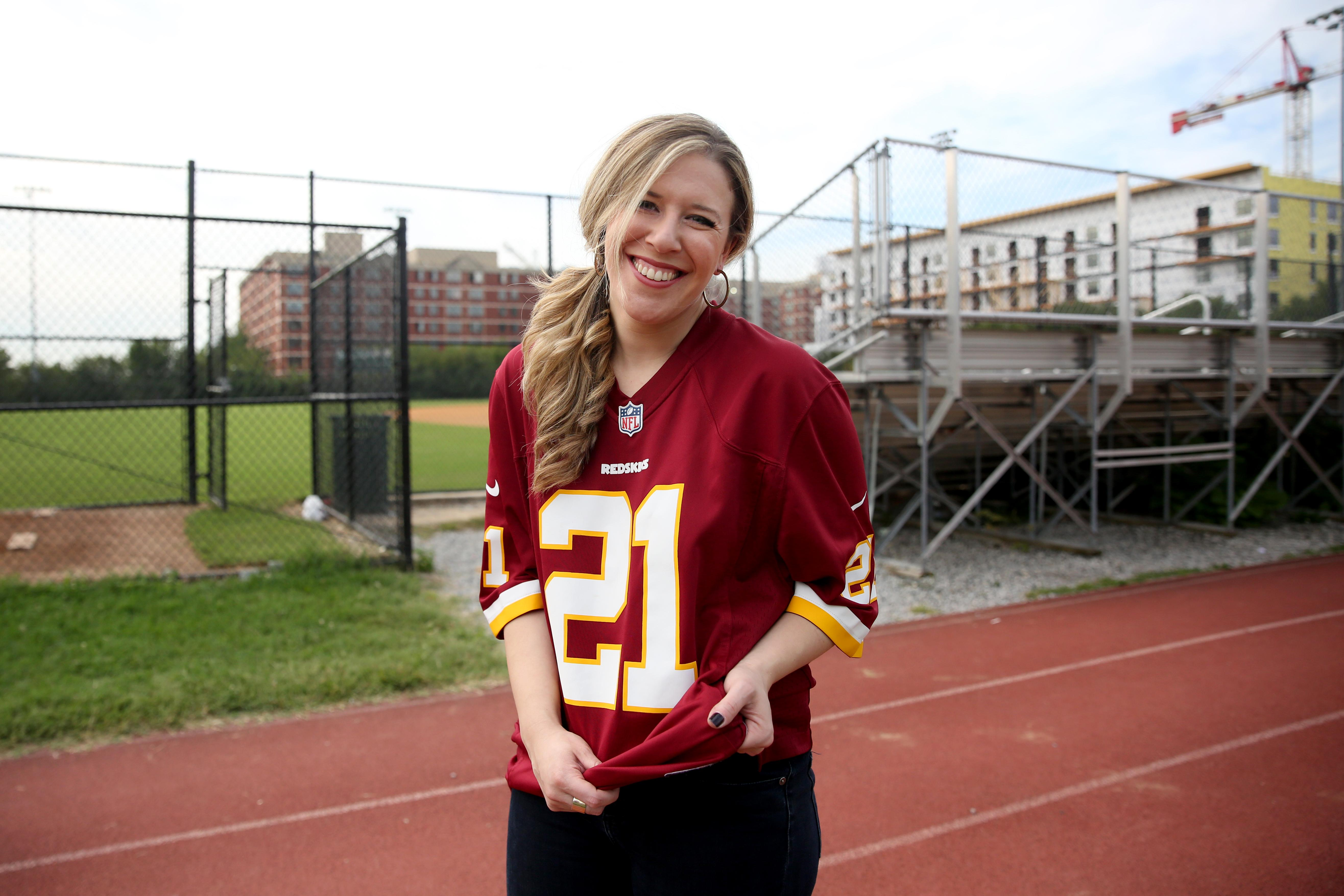 The ultimate sporty-girl fan: A football jersey, jeans, and hair up is all you need here. Show those guys you mean business. (Image: Amanda Andrade-Rhoades/ DC Refined)