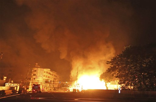 Flames from an explosion from an underground gas leak in the streets of Kaohsiung, Taiwan, early Friday.