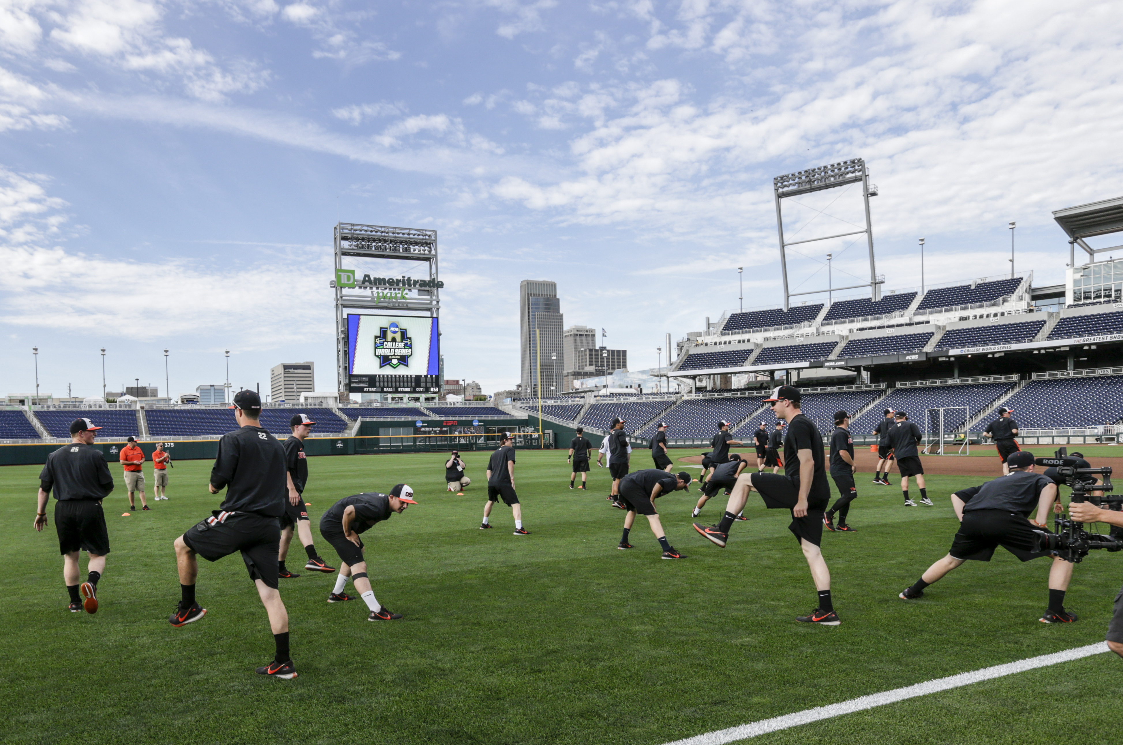 Oregon State players warm up at the start of team practice in Omaha, Neb., Friday, June 16, 2017. Oregon State is on the cusp of joining the company of the greatest college baseball teams of all time. At 54-4, the Beavers enter the College World Series with the fewest losses of any team since 1982. (AP Photo/Nati Harnik)