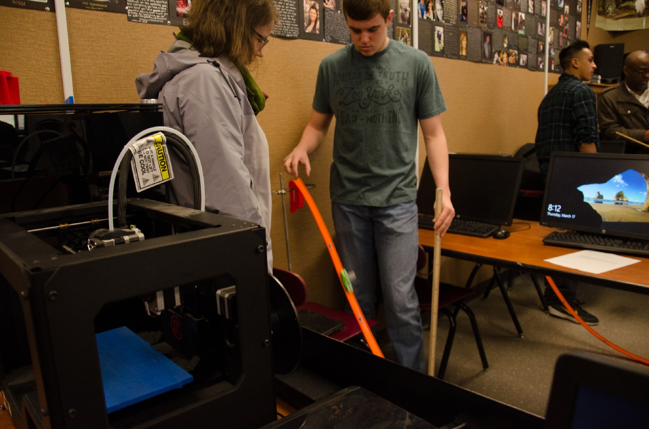 Students at Zillah HS explore physics, gravity and acceleration through the use of hot wheels cars – and a few equations, of course! Photo Credit: Danny Gross
