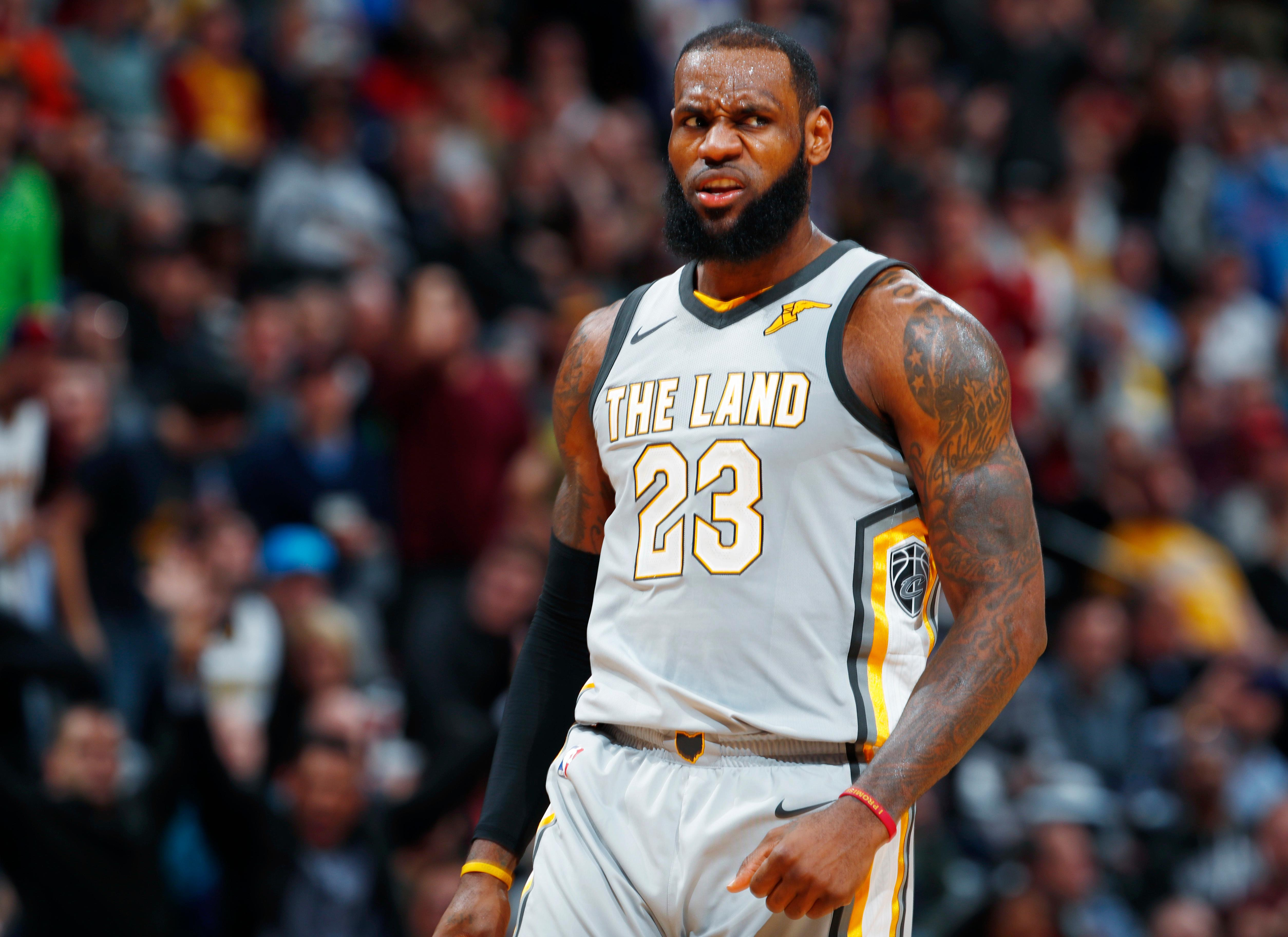 Cleveland Cavaliers forward LeBron James reacts after hitting a 3-point basket against the Denver Nuggets late in the second half of an NBA basketball game Wednesday, March 7, 2018, in Denver. The Cavaliers won 113-108. (AP Photo/David Zalubowski)