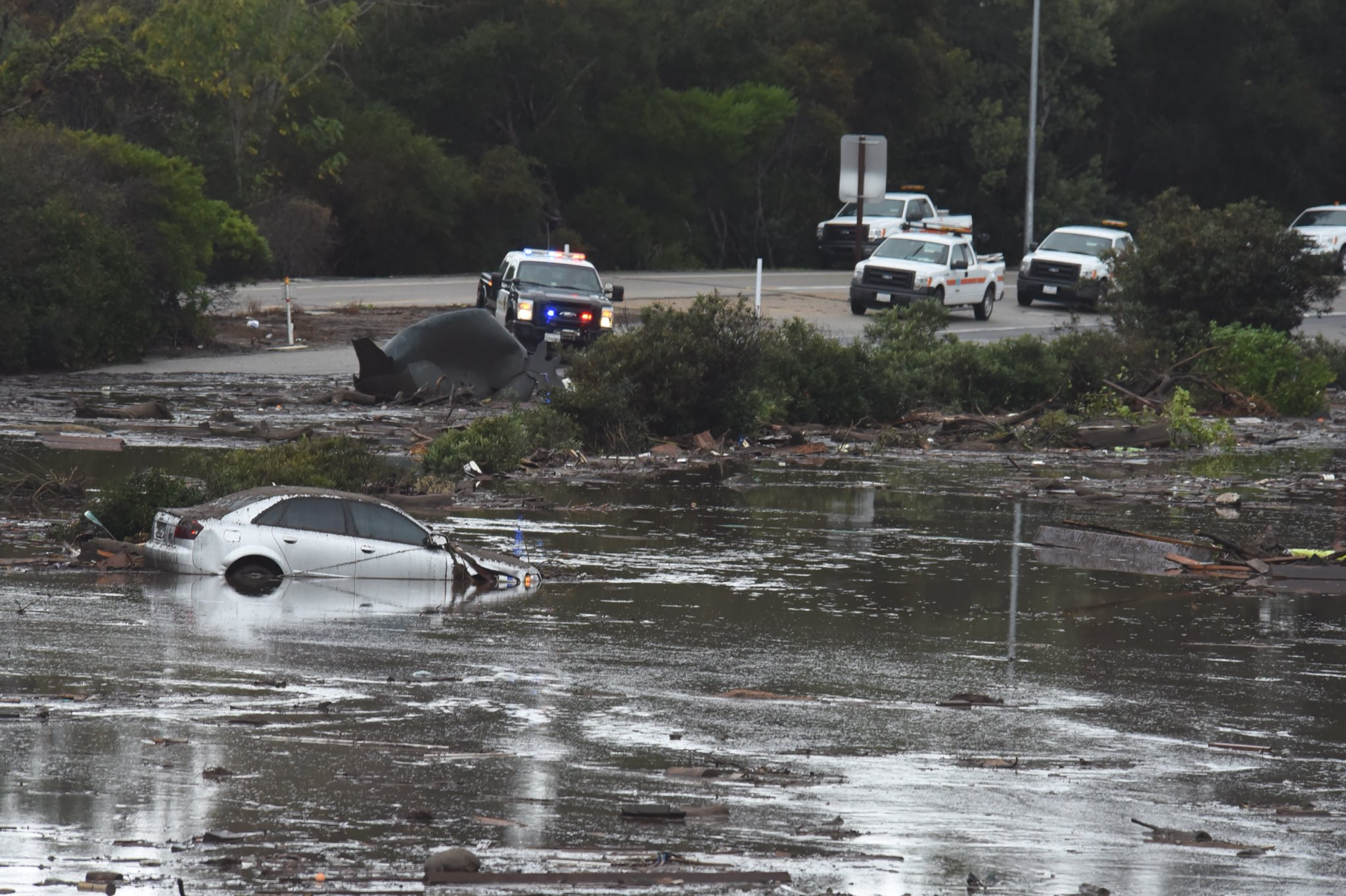 The US 101 Freeway at the Olive Mill Road overpass flooded with runoff water from Montecito Creek. (Photo & Caption: Mike Eliason / Santa Barbara County Fire)