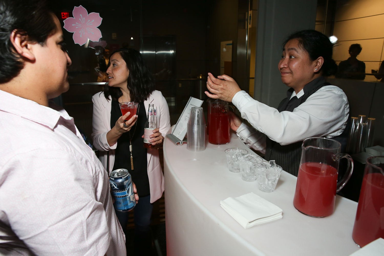 Hundreds of Washingtonians flocked to the Newseum on April 13 for their annual celebration of the cherry blossoms. 'In Bloom' featured small bites and drinks that could be enjoyed while strolling through the Newseum's substantial exhibits, including their new Photo of the Year feature, which opened last week. The evening included a bar inside the elevators, traditional Japanese performances and entertainment throughout the Newseum. (Amanda Andrade-Rhoades/DC Refined)