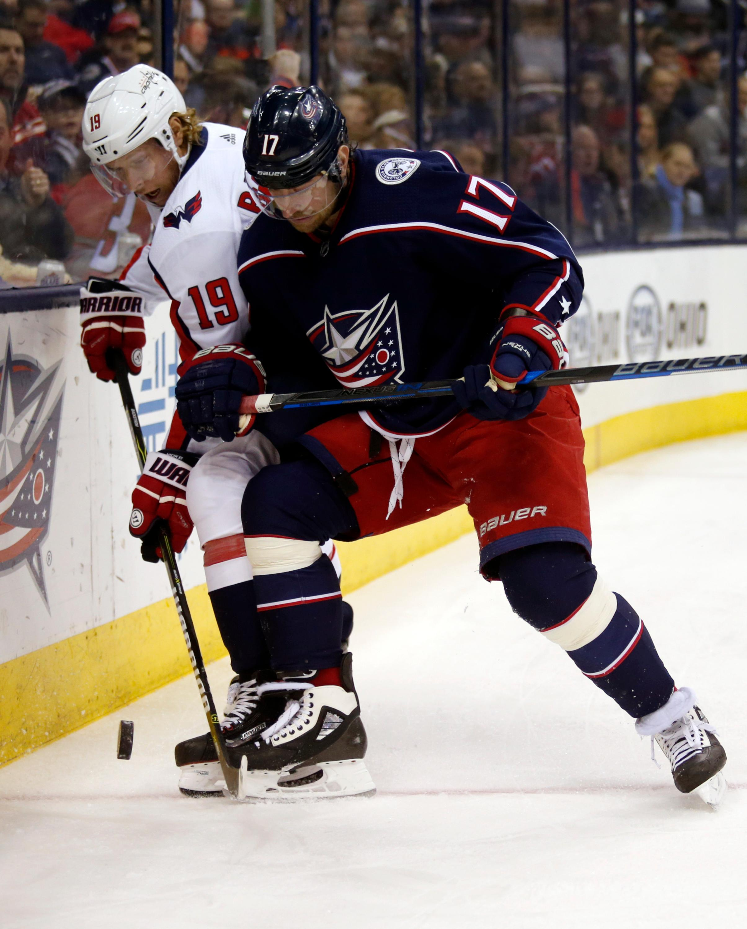 Columbus Blue Jackets forward Brandon Dubinsky, right, checks Washington Capitals forward Nicklas Backstrom, of Sweden, during the first period of an NHL hockey game in Columbus, Ohio, Monday, Feb. 26, 2018. (AP Photo/Paul Vernon)