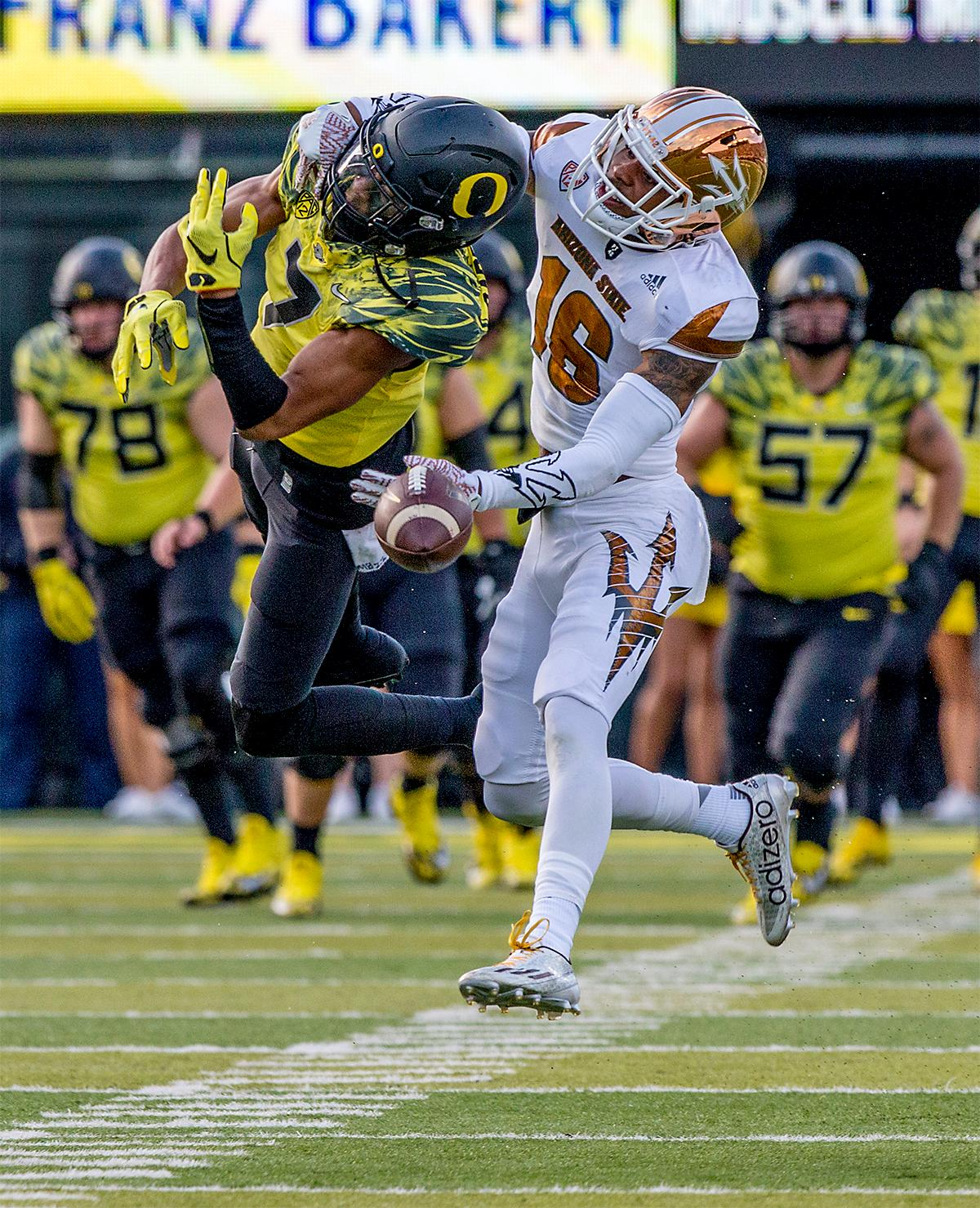 The Sun Devils' Maurice mo Chandler (#16) blocks an attempts by the Duck's Darren Carrington (#7) to make a catch. The Oregon Ducks broke their losing streak by defeating the ASU Sun Devils on Saturday 54-35. Photo by August Frank, Oregon News Lab