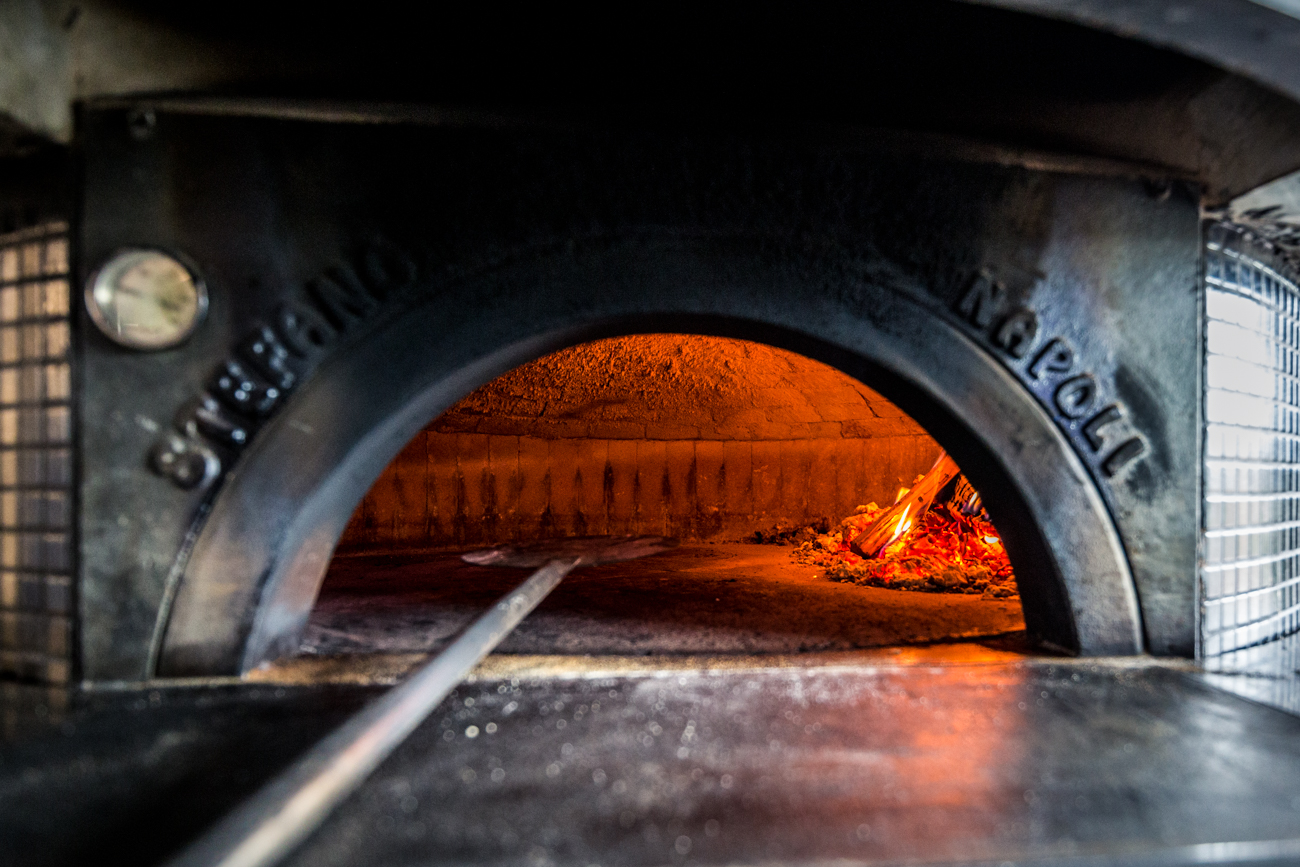The wood-fired ovens bake the pies at 900 degrees for 90 seconds to make the best, slightly charred, Neapolitan pizzas possible. Joe's Pizza Napoli is open Tuesday-Thursday 11 AM-9 PM, Friday and Saturday 11 AM-10 PM, and Sunday 11 AM-8 PM. / Image: Catherine Viox // Published: 6.17.19