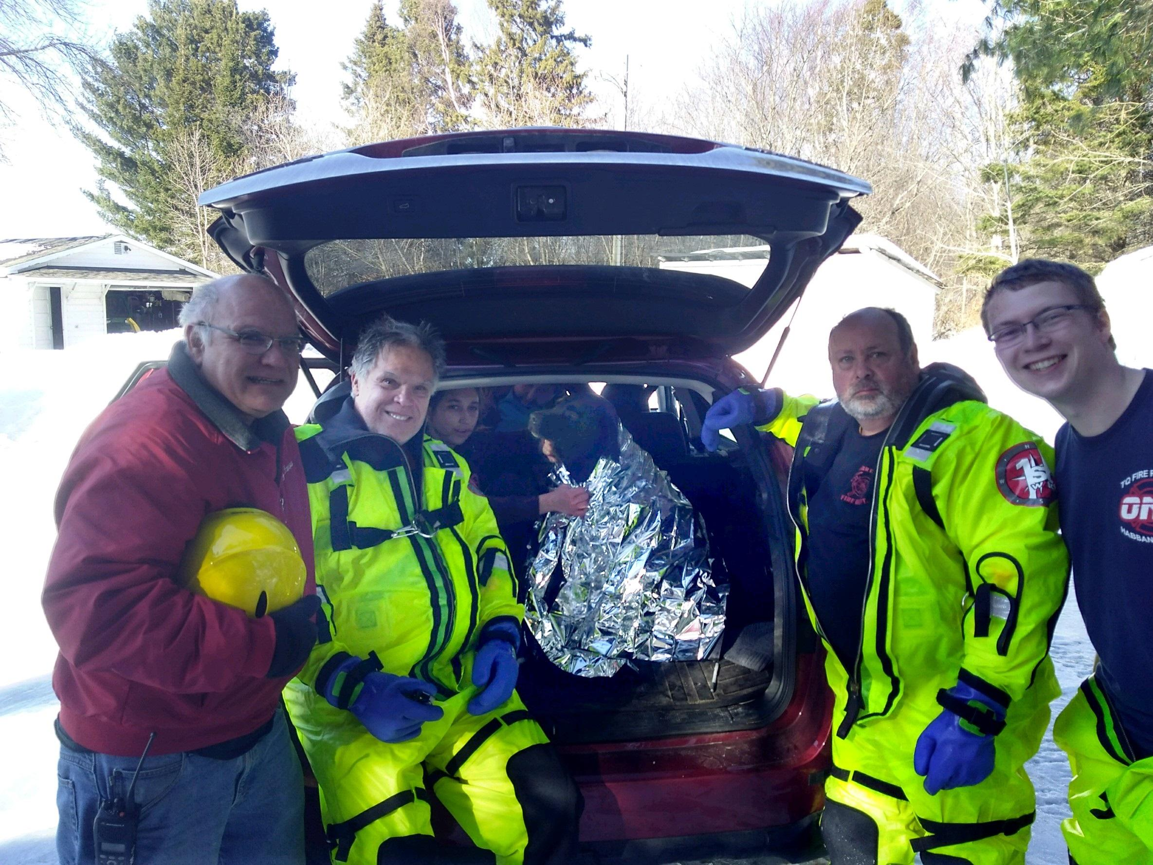 Four volunteer firefighters with the department were called to rescue a 5-year-old chocolate lab from the icy St. Mary's River last Thursday.  Photo courtesy: Lisa Martin