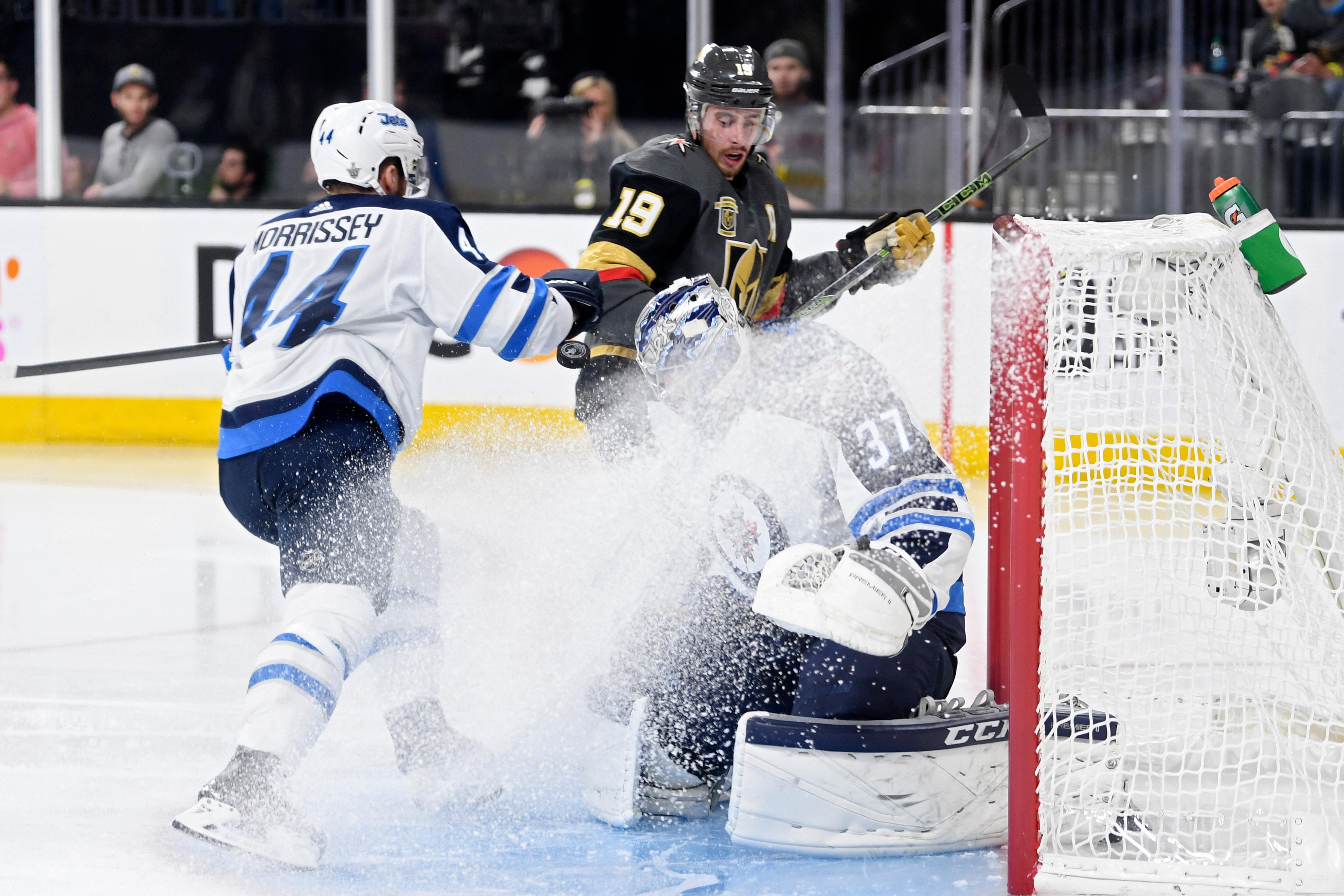 Winnipeg Jets goaltender Connor Hellebuyck (37) makes a stop in a spray of ice during Game 3 of their NHL hockey Western Conference Final game against the Vegas Golden Knights Wednesday, May 16, 2018, at T-Mobile Arena. CREDIT: Sam Morris/Las Vegas News Bureau