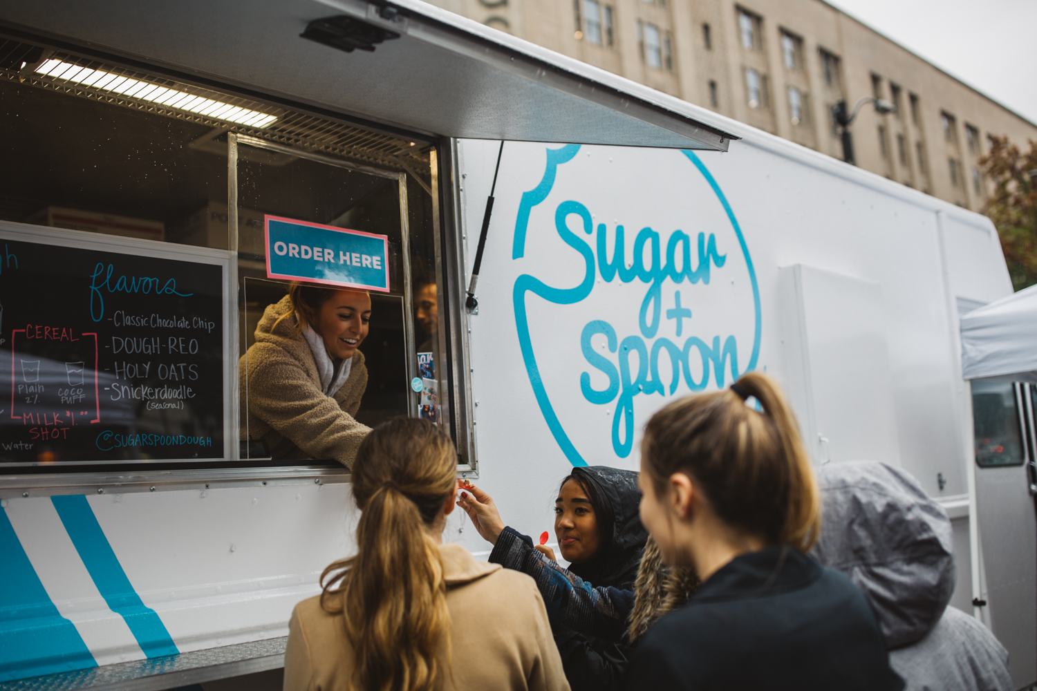 "Gone are the days of making a batch of cookies only to eat the cookie dough. Sugar + Spoon, a new Seattle food truck, serves up the most bangin' (raw and safe to eat) cookie dough we've ever eaten. Making their home in Westlake Park (for now), Sugar + Spoon's menu has several flavors of cookie dough including the popular ""dough-REO,"" ""holy oats!"" and more. They also have ""Cereal Milk Shots"" that are infused with fruity pebbles cereal. We recommend washing down some cookie dough with one of these shots. It is a sweet lovers dream on wheels. You can find Sugar + Spoon on their website as well as their instagram page to look at their pop-up schedule (Image: Ryan McBoyle / Seattle Refined)."