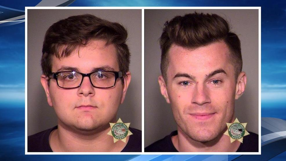 Booking photos for Paul Paliy and Petro Hurzhuy from Portland Police.jpg