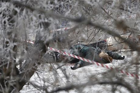Victims' bodies lie outside a wreckage of a trolleybus in Volgograd, Russia, Monday, Dec. 30, 2013. Volgograd is about 650 kilometers (400 miles) northeast of Sochi, where the Olympics are to be held.