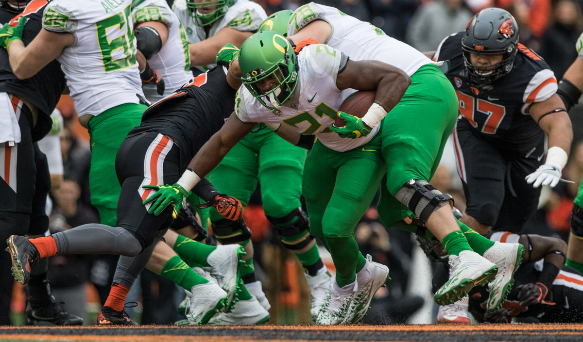 Oregon Ducks running back Royce Freeman (#21) pushes his way forward underneath a teammates block. The Oregon State University Beavers hosted the 120th Civil War against the University of Oregon Ducks on Saturday afternoon at Reser Stadium in Corvallis, Ore. The Oregon State Beavers beat the Oregon Ducks 34-24 breaking an eight-year losing streak. Photo by Austin Hicks, Oregon News Lab
