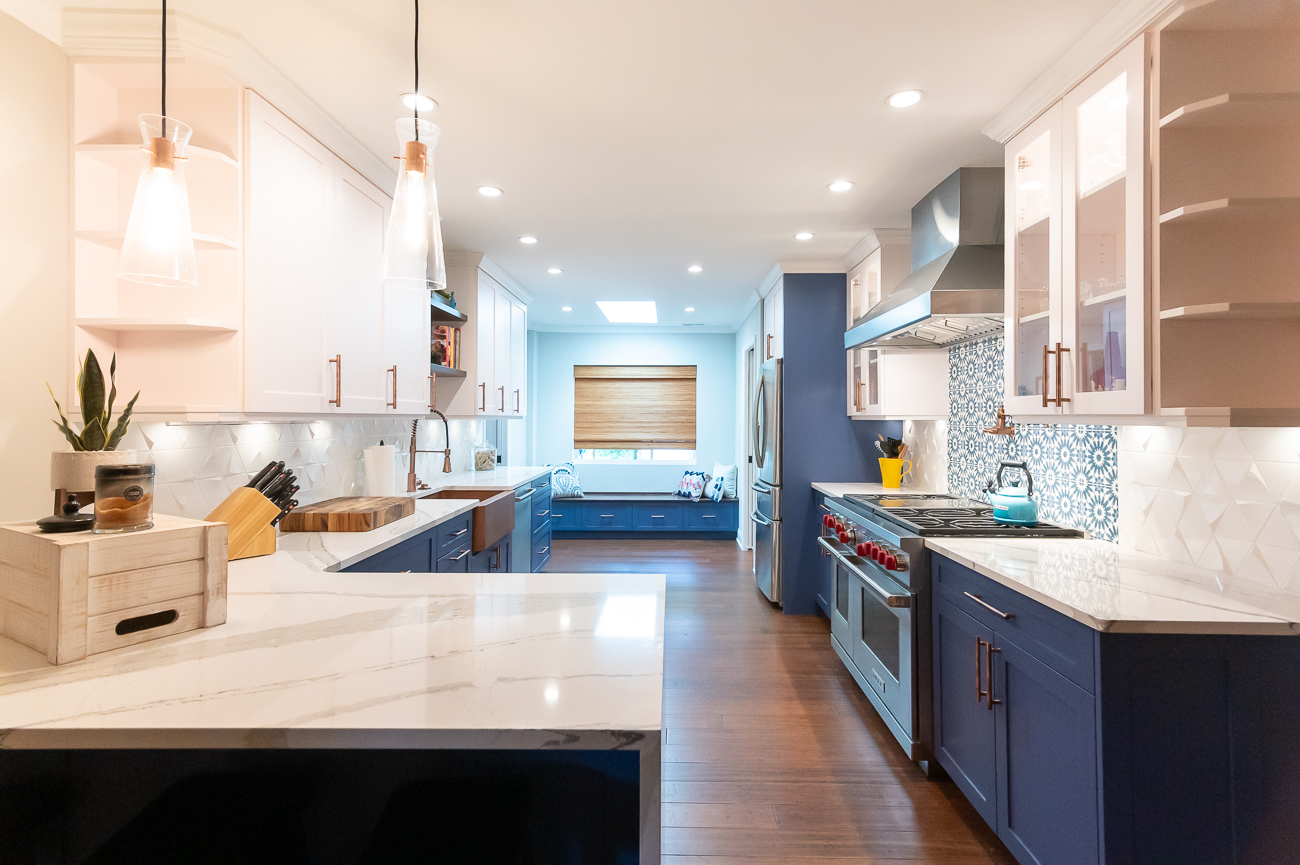 They opened up the kitchen, replaced all the hardware and appliances, added custom cabinetry, Cambria Brittanicca countertops, and tile backsplashes. / Image: Phil Armstrong, Cincinnati Refined // Published: 6.5.20