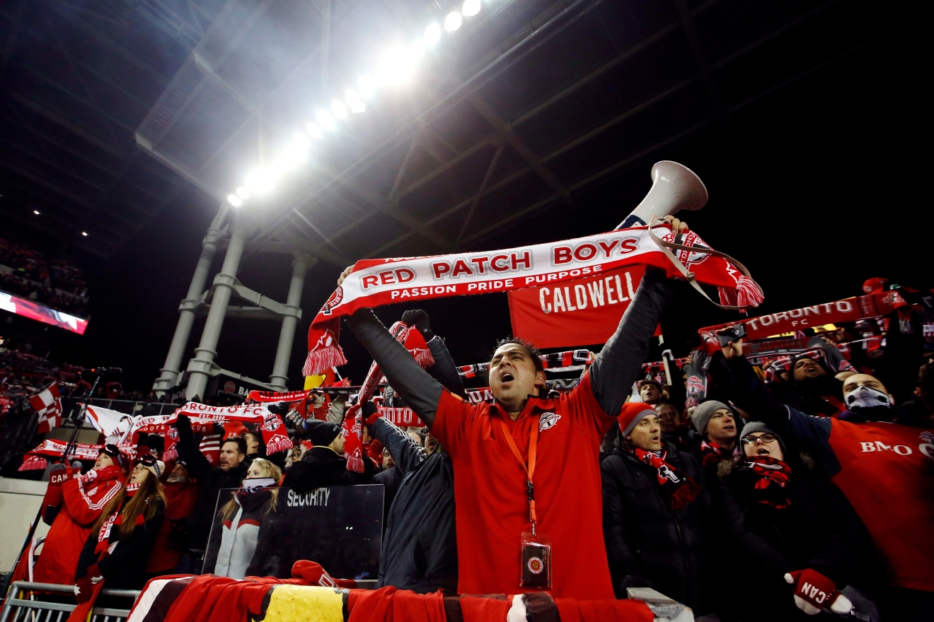 Toronto FC fans cheer during first-half MLS Cup final soccer action against the Seattle Sounders in Toronto, Saturday, Dec. 10, 2016. (Mark Blinch/The Canadian Press via AP)